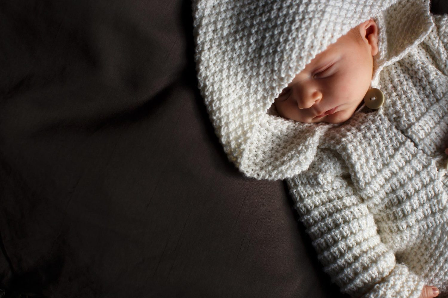 newborn baby with cute knitted hood